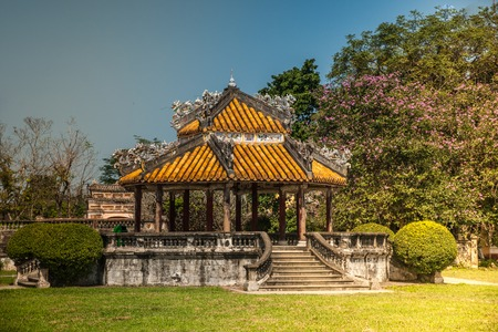 hue: Beautiful pavilion in parks of citadel in Hue, Vietnam. Historic architecture of central Vietnam. Stock Photo