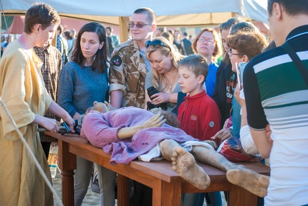 mummification: MOSCOW - JUNE 06, 2015: Historical reenactment of mummification in Ancient Rome. Times and Ages International Historical Festival in Kolomenskoye, Moscow.