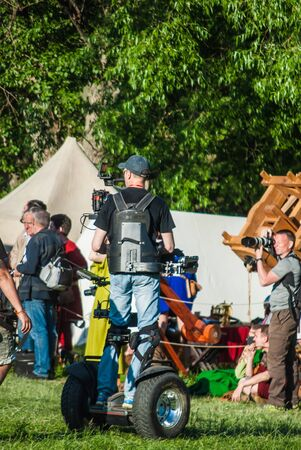 reportage: MOSCOW - JUNE 06, 2015: Cameraman on Steadiseg shooting historical reenactment in Kolomenskoye, Moscow. Steadiseg is easy way to capture smooth tracking shots at a fairly brisk pace. Editorial