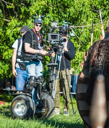 fairly: MOSCOW - JUNE 06, 2015: Cameraman on Steadiseg shooting historical reenactment in Kolomenskoye, Moscow. Steadiseg is easy way to capture smooth tracking shots at a fairly brisk pace. Editorial