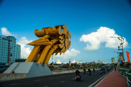 developement: DANANG CITY, VIETNAM - FEBRUARY 2, 2015 - Traffic on the The Dragon Bridge on February 2, 2015. The Bridge has recently received Engineering Exellence Award (EEA) in the USA