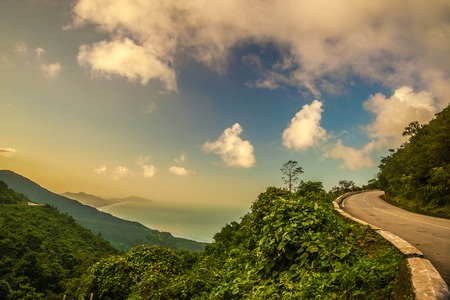 Hai Van pass - the famous road which leads along the coastline mountains near Da Nang city, Vietnam. Beautiful nature and transportation background. Stock Photo