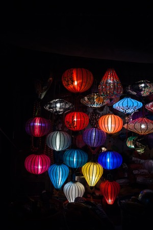 Night lanterns in old Hoi An town in Vietnam. Background of ancient eastern culture. Multiple colors and bright lights.
