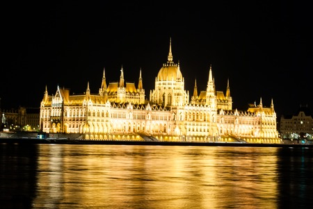 neo gothic: The Hungarian Parliament Building with bright and beautiful illumination at night. It is the seat of the National Assembly of Hungary, one of Europes oldest legislative buildings