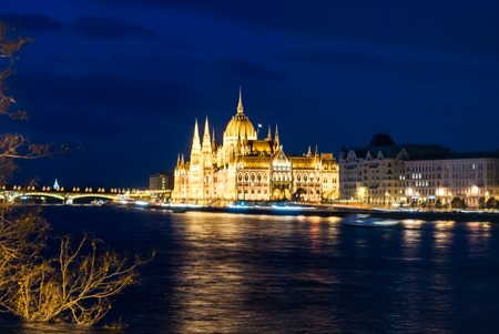 obuda: Budapest Cityscape at night. With the Hungarian Parliament and Margit Bridge. Beautiful reflection in the water of Danube river.