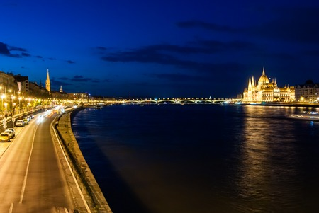 nightime: Budapest Cityscape at night. With the Hungarian Parliament and Margit Bridge. Beautiful reflection in the water of Danube river.