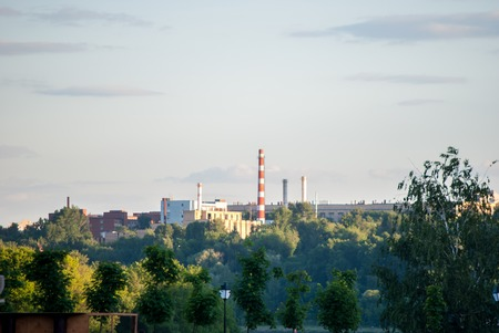 powerplant: Powerplant seen in distance surrounded by nature. Symbol of Technology, pollution and urbanism
