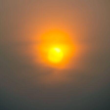 dark clouds: bright sun in an orange sky with dark clouds at sunset Illustration