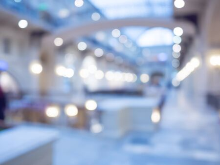 Defocused interior of a large luxury shopping center. Abstract background for web usage.
