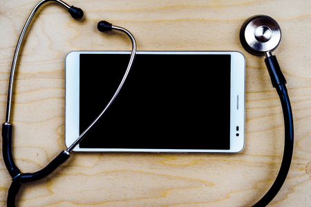 stethescope: Stethoscope with a tablet computer on wooden table. Medical background Stock Photo