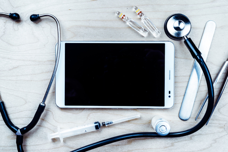 stethescope: Tablet pc with medical objects on a desk Stock Photo