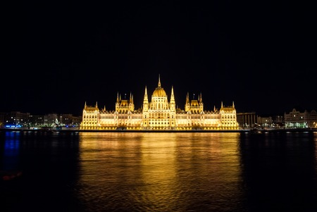 europe: The Hungarian Parliament Building with bright and beautiful illumination at night. It is the seat of the National Assembly of Hungary, one of Europes oldest legislative buildings