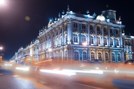 Russian palace: Beautiful night view of Winter Palace in Saint Petersburg. Traffic light and lanterns create colorful illumination for prominent russian landmarks. Saint-Petersburg, Russia