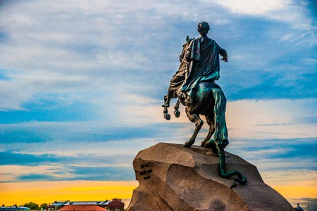 horseman: The Bronze Horseman - equestrian statue of Peter the Great in Staint-Petersburg, Russia. One of the major tourist attractions viewed in the direction of Neva river against beautiful sky at sunset. Stock Photo