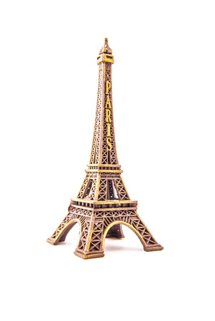 Photo of little model of Eiffel Tower isolated on white. Image of travel in France and symbol of Paris. Stock Photo