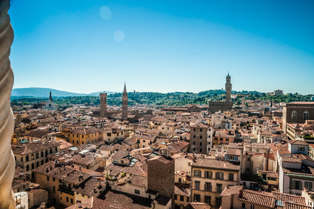 medici: Florence, Italy. Cityscape with tiled roofs and Palazzo Vecchio in the distance