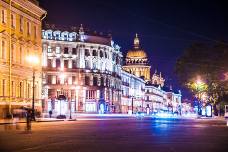 saint: Beautiful night view of Nevsky Prospect and Isaacs Cathedral near Palace Square in Saint Petersburg. Colorful illumination for prominent russian landmark. Saint-Petersburg, Russia Stock Photo