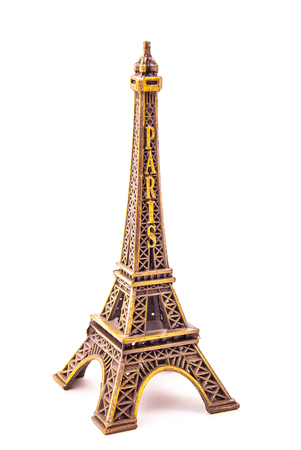 little model: Photo of little model of Eiffel Tower isolated on white. Image of travel in France and symbol of Paris. Stock Photo