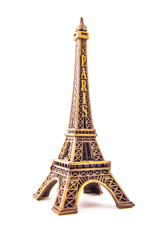 little colours: Photo of little model of Eiffel Tower isolated on white. Image of travel in France and symbol of Paris. Stock Photo