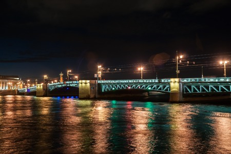 turistic: Beautiful night view of Saint-Petersburg, Russia, with famous Palace Bridge on Neva river, Peter and Pavel fortress and Vasilievsky island. Stunning turistic imagery. Most prominent russian landmarks. Stock Photo