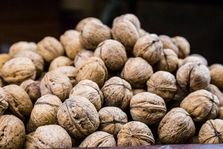 plenty: Plenty of walnuts. Image of harvest, autumn, and vegetarian food. Raw food texture. Nuts texture background. Stock Photo