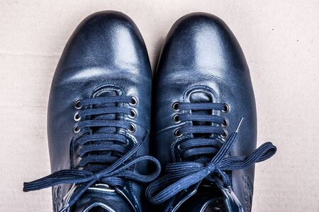 solid background: Mens shoes for autumn on light solid background. Blue boots on the ground. Stock Photo