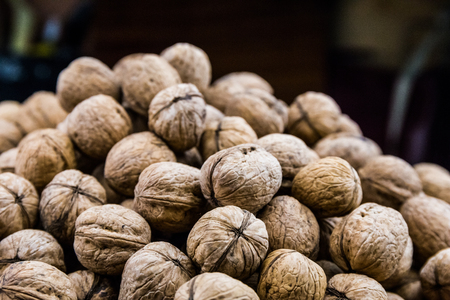eating right: Plenty of walnuts. Image of harvest, autumn, and vegetarian food. Raw food texture. Nuts texture background. Stock Photo