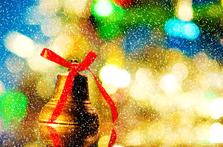 decorated tree: christmas bell near decorated tree