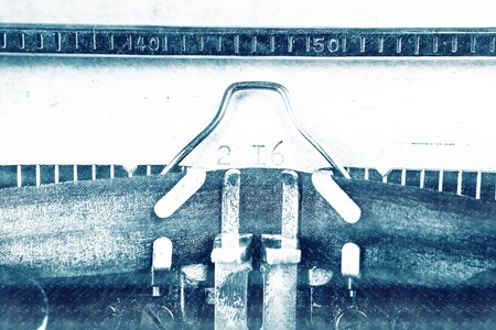 writing activity: Vintage typewriter with shwwt of paper and printed 2016 digits. Closeup photography for blog and creative banners, or hero image. Symbol of blogging, writing, internet activity and creativity.