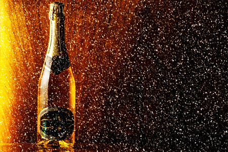 champagne bottle: bottle of champagne on wooden background