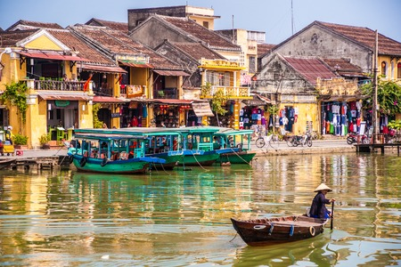 HOI AN, VIETNAM - FEBRUARY 5, 2015: Traditional boats in Hoi An. Hoi An is the Worlds Cultural heritage site, famous for mixed cultures & architecture.