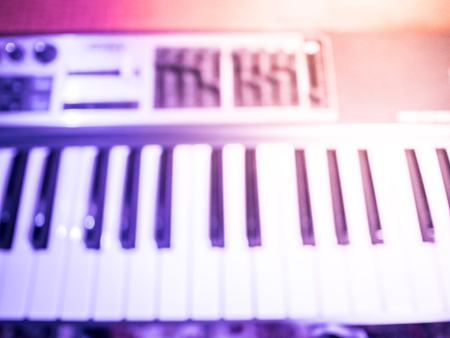 electronic piano: Electronic piano with keys in the foreground. Musical background image. Stock Photo