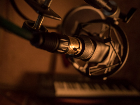 Electronic piano with microphone. Musical background image. Recording studio equipment.