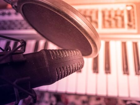 electronic piano: Electronic piano with microphone. Musical background image. Recording studio equipment.