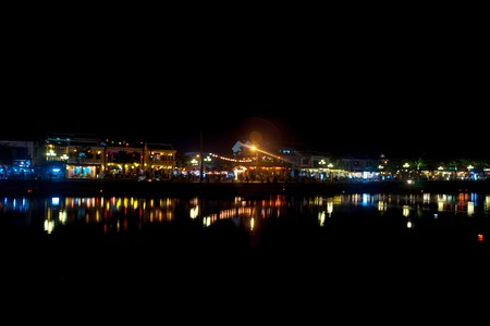 hdri: Night view of Hoi An town with light illumination and reflection in the river, Vietnam. Hoi An is the Worlds Cultural heritage site, famous for mixed cultures and architecture. Stock Photo