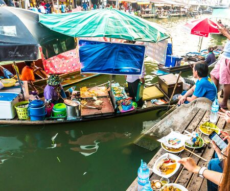 saduak: Traders boats in a floating market in Thailand. Floating markets are one of the main cultural tourist destinations in Asia.