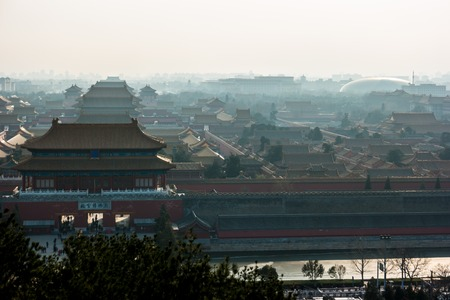 architectural tradition: An aerial bird view of the the famous Forbidden City in Beijing, China. The vast area of the architectural complex is covered with evening mist.