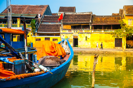 Traditional boats in front of ancient architecture in Hoi An, Vietnam. Hoi An is the Worlds Cultural heritage site, famous for mixed cultures & architecture.
