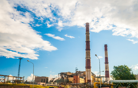 smokestacks: Coal Fossil Fuel Power Plant with Smokestacks, energy plant in sunset light.
