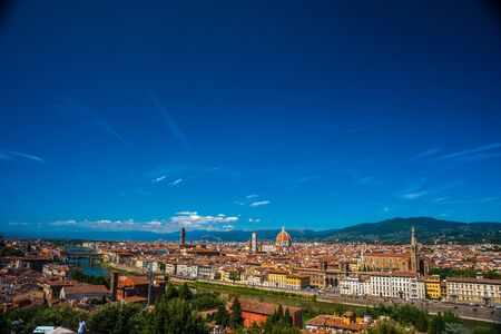 Florence, Italy. Beautiful cityscape image with red roofs of renaissance and medieval architecture. Stock Photo