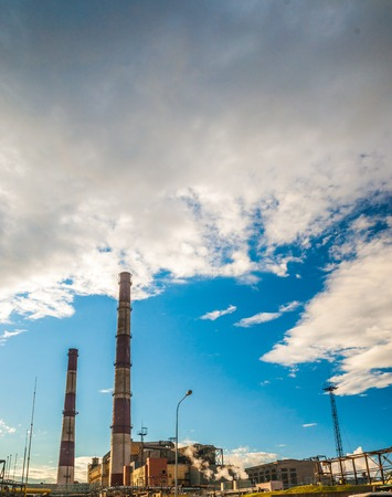 fossil fuel: Coal Fossil Fuel Power Plant with Smokestacks, energy plant in sunset light.