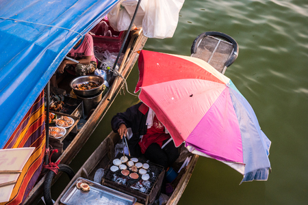 practised: Colorful traders boats in a floating market in Thailand. Floating markets are one of the main cultural tourist destinations in Asia. Stock Photo
