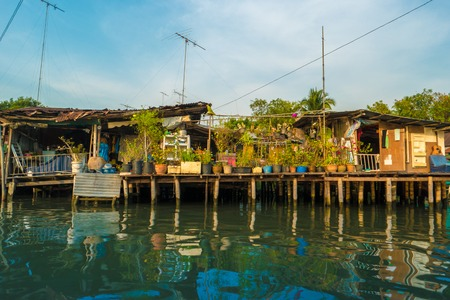 klong: Stilt houses built above river Mae Klong in Amphawa, rural Thailand. Beautiful countryside landscape at sunset.