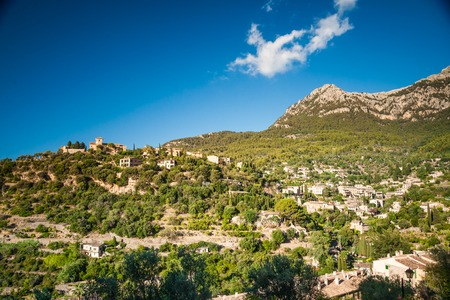 mediterranian houses: Beautiful view of a small mountain village Deia in Mallorca, Spain. Houses built on hills in Deia mountain village in Majorca island, Spain.