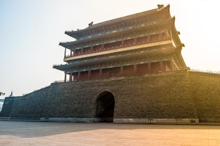 gatehouse: Beijing, China at the Zhengyangmen Gatehouse in Tiananmen Square. Beautiful historical building at sunset. Stock Photo