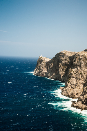 northern spain: Famous Cap de Formentor, cliff on the northern part of Mallorca island, Spain. Big rocky mountains with lighthous in distance. Tourist destination in Spain.