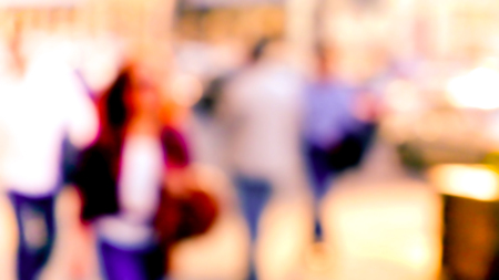 back home: City commuters. Blurred image of workers going back home after work. Unrecognizable faces, bleached effect.