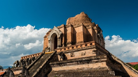 monastic: The temple wat Chedi Luang in Chiang Mai, Thailand. Big and beautiful ruins of ancient architecture in Thailand. Beautiful travel picture of Asia.