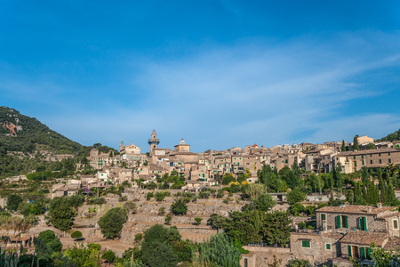 Beautiful view of the small town Valldemossa situated in  picturesque mountains on Mallorca island, Spain. Stock Photo
