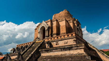 The temple wat Chedi Luang in Chiang Mai, Thailand. Big and beautiful ruins of ancient architecture in Thailand. Beautiful travel picture of Asia.